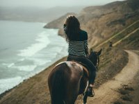 Horseback riding on the shores of the Pacific Ocean