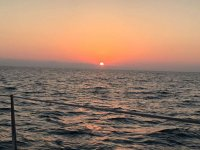 Contemplate beautiful sunsets on the high seas