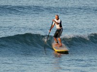 Learn to surf in the waves