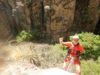 Maximum adrenaline descending with rappel into the cave