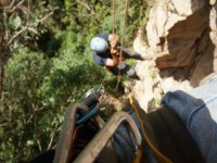 Ascending the ropes to return to the surface in La sima de Las Cotorras