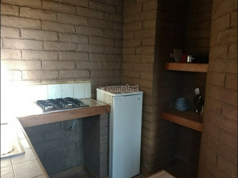 It has an equipped kitchen