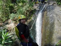 Rappel descent in waterfall
