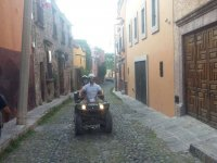 On ATV between the streets