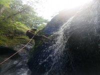 Rappel by waterfalls