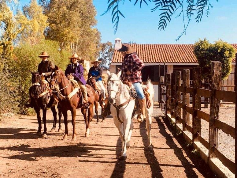Leaving the village on horseback