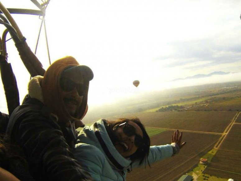 Couple flying in balloon