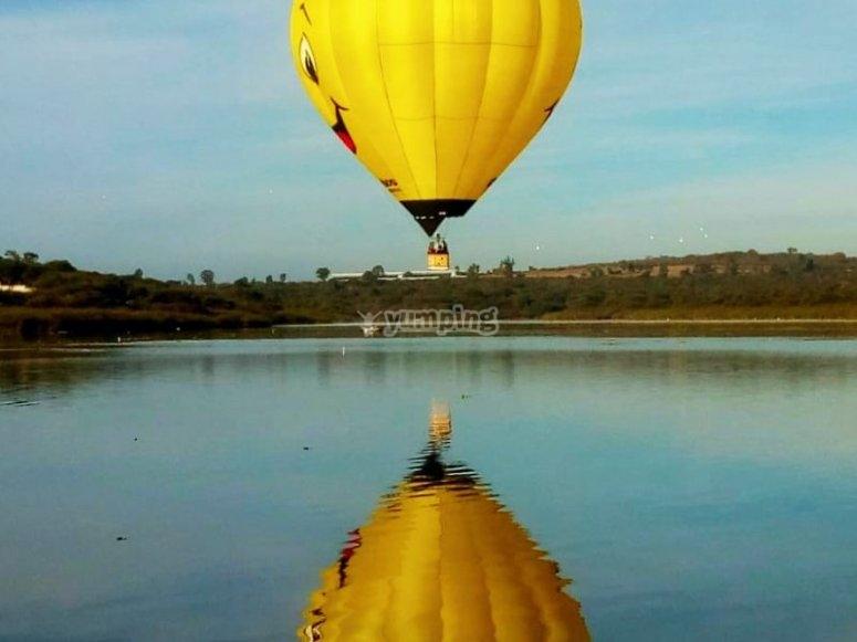 Balloon in valley landscape