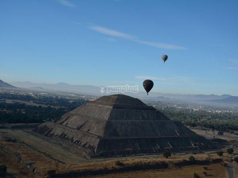 Balloons on horizon along with pyramid