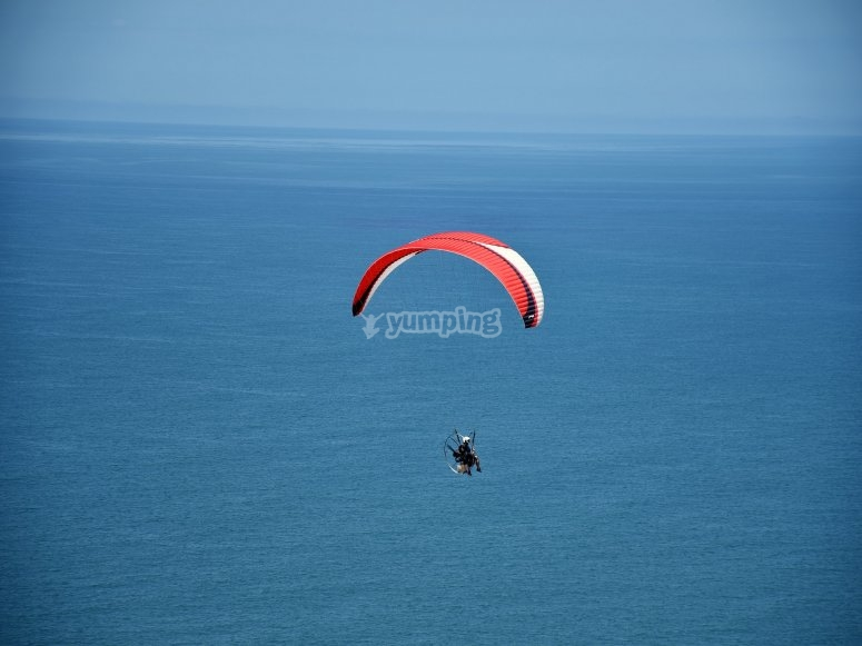 Paramotor over the sea