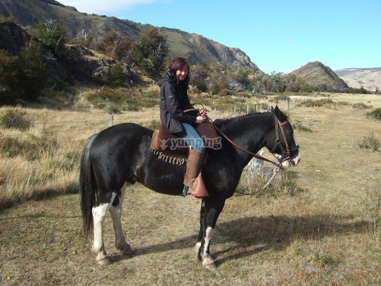 Happy riding a horse