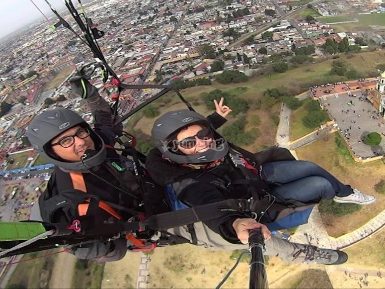 Enjoying the tandem paragliding