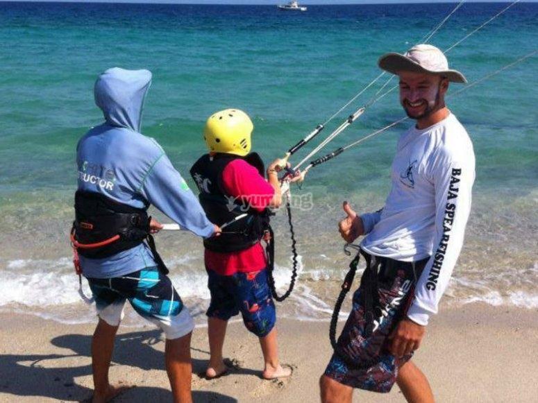 Children learning kitesurf