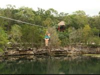 Feel the adrenaline when sliding on our zip line over the lagoon