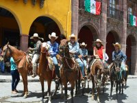 Horseback riding through the center of san miguel