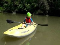 Child paddling in a kayak