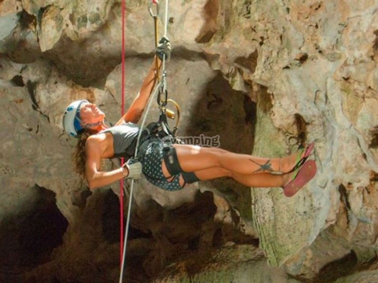 Rappelling down a cenote
