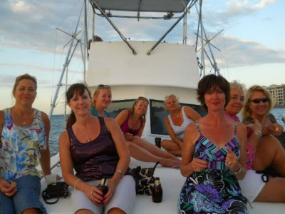 Shared boat at sunset and drinks in Cozumel