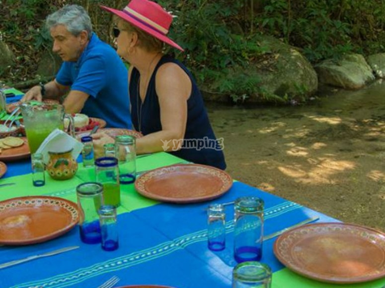 Enjoy lunch on the banks of the river