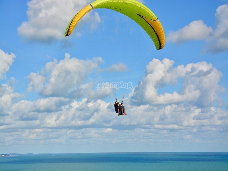 Paragliding flight over the Pacific Ocean