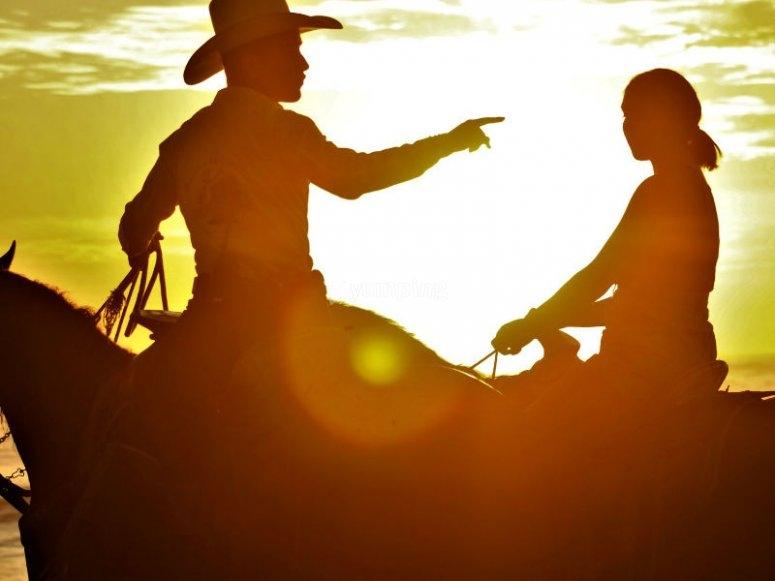 Enjoy a beautiful sunset on horseback