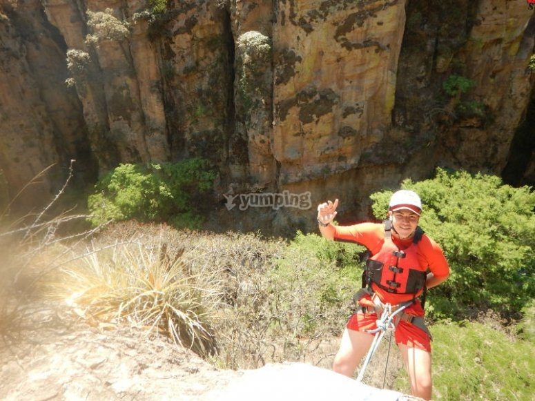 Rappel to reach the cave