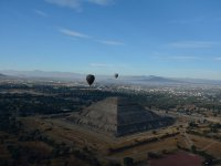 Horizon with balloons and pyramid