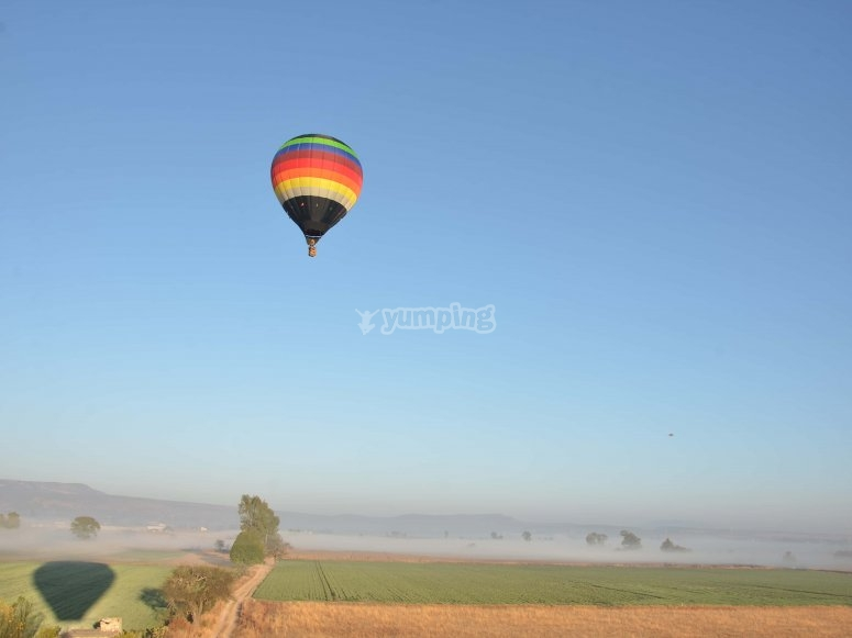 Flying on the horizon in a balloon