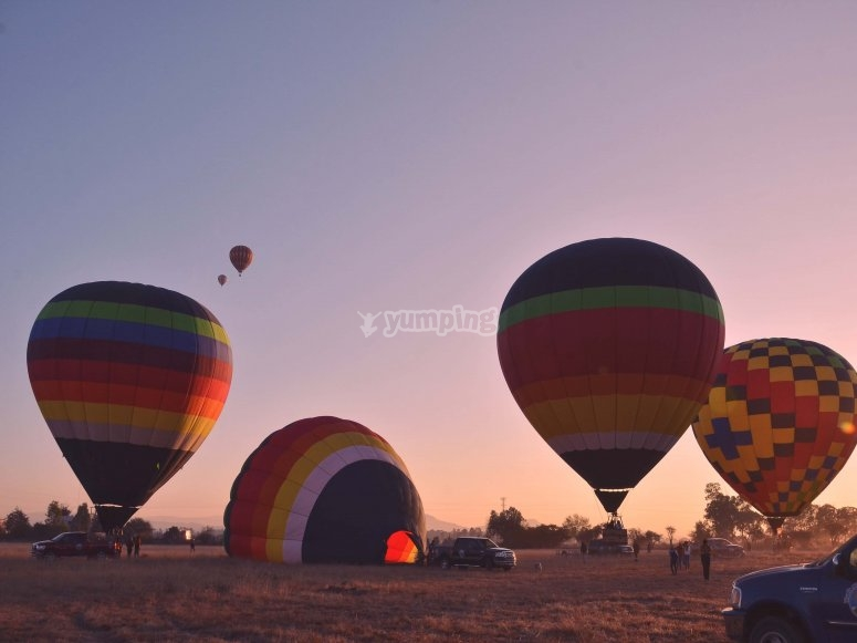 Spectacular sunrise with hot air balloons