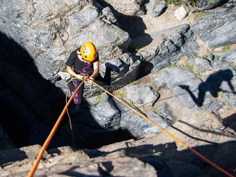 Descend the rocks to reach the stream