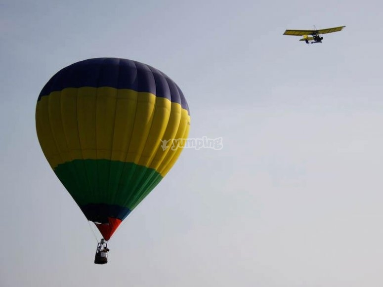 Flying in a balloon next to a plane