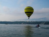 Flying in a balloon over lake