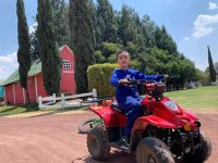 Bring your child for a ride in ATV