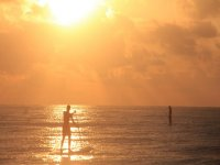Enjoy the sunset while you do stand up Paddle in Tulum
