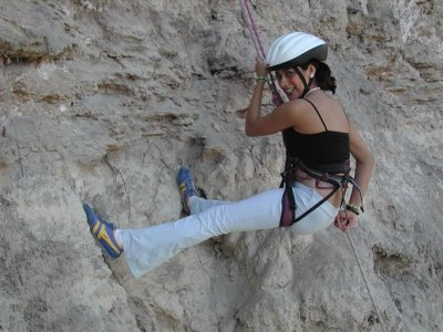 Rappelling by natural rock walls in Apotla