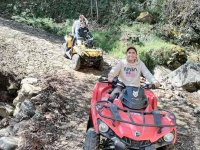 Ride on an ATV part of the mountains and paths made with rocks