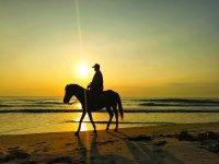 Riding at sunset