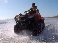Two-seater quad bike in the sea