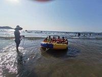 Friends in a water chair Playa Linda Ixtapa