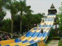 Going down the slide at full speed