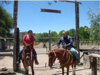 Horseback riding in couple