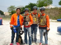 Team playing paintball