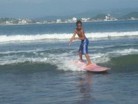 child learning surfing