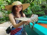 With a crocodile calf