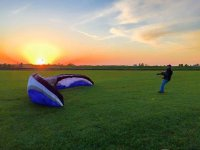 The paraglider in the sun fall