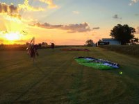 The sun falling after the paraglider