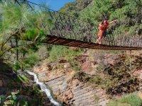 Cross our suspension bridge