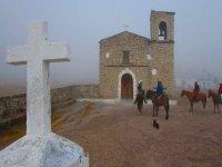 Travel in the fog on horseback
